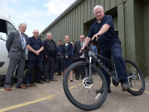 Duncan MacLachlan on his long service award of a bike.  Picture by Iain Ferguson/The Write Image