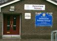 Images of vandalised windows at Danestone Primary School.
