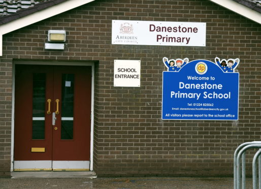 Images of vandalised windows at Danestone Primary School.