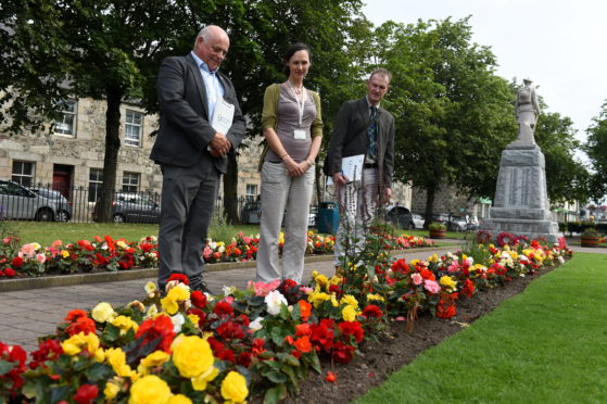 "Keep Scotland Beautiful judges was in Inverurie judging the town in the ""medium sized town"" category.  Left to right, Sandy Scott, Juliette Camburn and Adrian Miles at Market Square."
