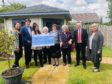 Representatives from Leys Group donate to the Forget Me Not Club