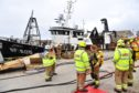 Fire crews at Macduff Harbour yesterday