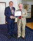 Ken Wilson receives his Paul Harris Award from outgoing President James Campbell