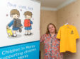 Debi Weir with samples of the various school jumpers available.