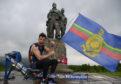 Matthew Disney celebrates the end of his challenge at the Commando Memorial. Photo by Iain Ferguson