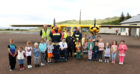 Cameron  Allen (centre chair) with the children and members of Oban Airport Fire crew Tom Eddelston, Murray MacGregor, Katherine Dempster who organised the walk and the refreshment  and paul mackay  who walked the perimeter of Oban Airport to raise funds for Cameron to complete his course picture kevin mcglynn