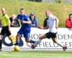 Cove Rangers' Harry Milne (R) against Peterhead winger Aidan Smith.