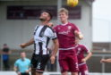 Betfred Cup Arbroath v Elgin City Gayfield Park, Arbroath Pictured are Elgin captain Matthew Cooper and Arbroath's Colin Hamilton Picture by DARRELL BENNS     Pictured on 21/07/2018