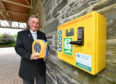 Ian Bryson, Crematorium Manager at Moray Crematorium with a newly installed heart defibrillator.   Pictures by JASON HEDGES