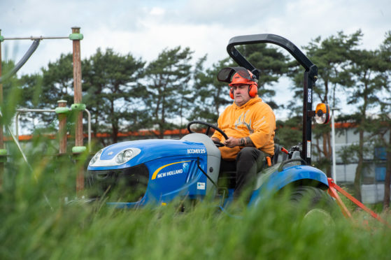 Pictures by JASON HEDGES      A grass cutter is pictured at Doocot Park, Moray.  Pictures by JASON HEDGES