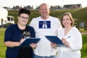 Dual Peterhead group asking for signatures. Picture of (L-R) Sianan Watson, Bruce Buchan and Lisa Buchan.