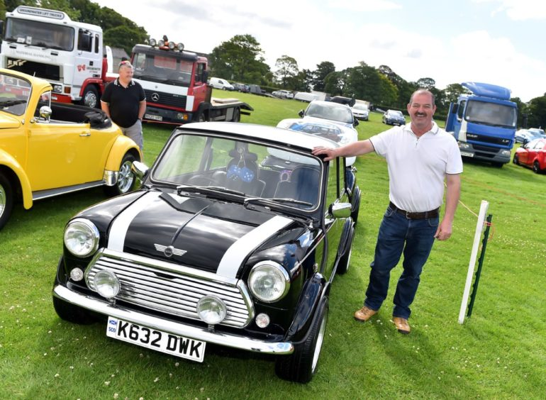 Ian Sutherland with his Mini Cooper, 1992  Picture by Scott Baxter