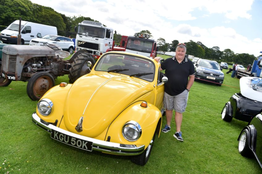 John Macaskill. with his 1971 VW Beetle Convertible,    Picture by Scott Baxter