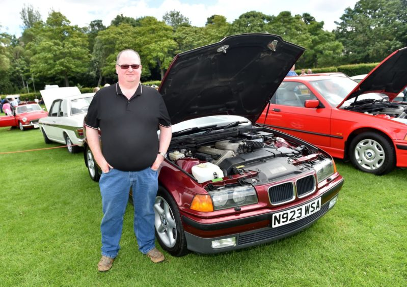 Brian Foreman with BMW 318. 1996.    Picture by Scott Baxter