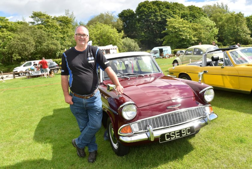 Ian Wilson with his 1965 Anglia Super.   Picture by Scott Baxter