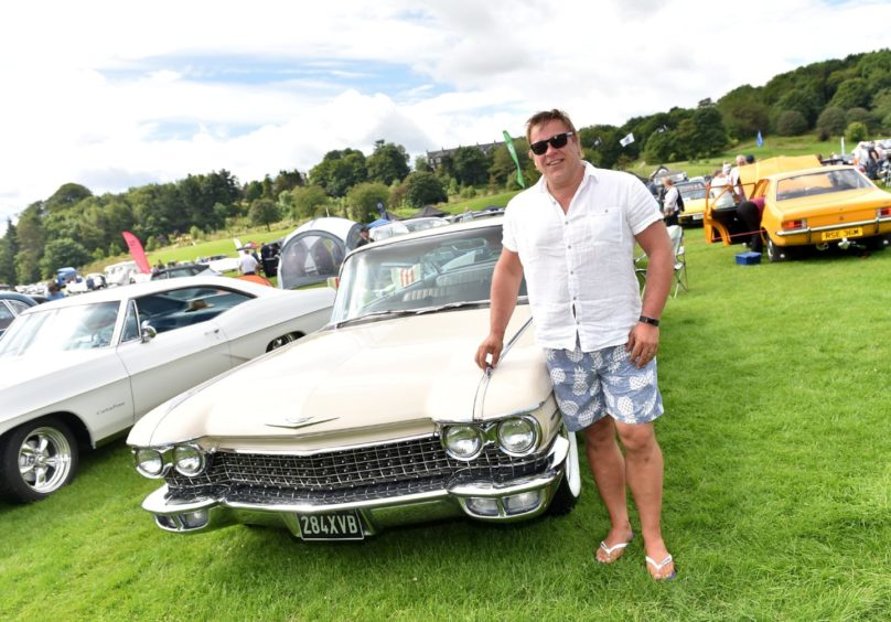 Keith Stewart with a 1960 Cadillac.   Picture by Scott Baxter