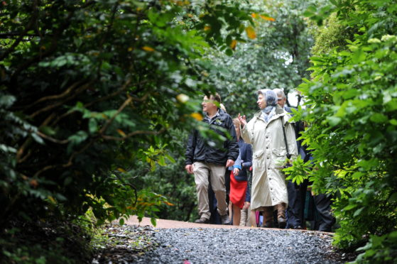 HRH The Princess Royal tours: Inverewe Gardens, Poolewe guided by Kevin Ball, Head Gardener.