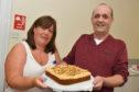 Derek Jones shows his entry for the Peterhead bake off to Scottish Week committee member Caroline Weir.