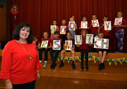 NEW DEER HEAD TEACHER WILMA MUTCH GETS A SEND OFF FROM HER PUPILS AFTER 40 YEARS OF SERVICE