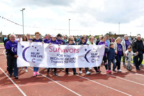 RELAY FOR LIFE , PETERHEAD.  CANCER SURVIVORS  DO THE FIRST LAP OF THE TRACK AT LORD CATTO PARK.