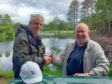 Colin Lipscomb (right) presenting cheque to Friends of Blairs Loch Treasurer, Brian Higgs (left) at Loch of Blairs on the Altyre estate, Forres.