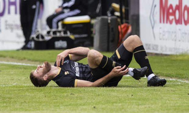 Shaun Rooney was injured just minutes into the game against Aberdeen.