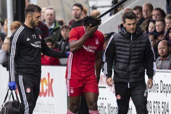 Aberdeen's Greg Leigh leaves the field with an injury
