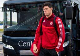Aberdeen defender Scott McKenna heads for Finland.