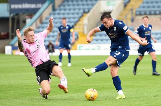 Peterhead's Aidan Smith blocks a shot from Dundee's Jordan Marshall.