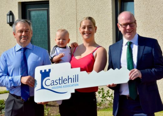 David Lappin, chief executive at Castlehill, tenant Alanna Begg and her son Blak and  housing minister Kevin Stewart