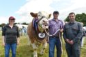 Overall Champion -  Simmental with (from left) The Smith family,  Morag, gerald and Douglas.
