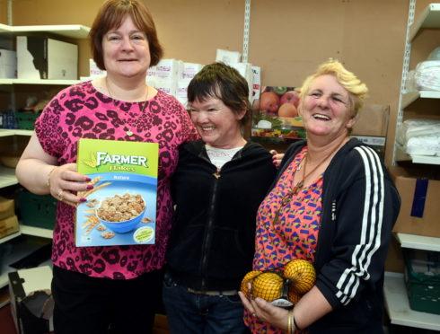 Left to right: Foodbank volunteers Angela Wilson, Winnie Coleman and Susan Allan.