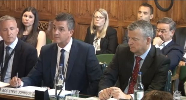 Assistant Chief Constable Steve Johnson (centre) giving evidence to the Scottish Affairs Committee