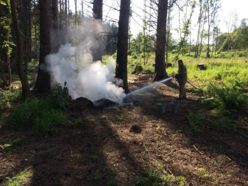 Firefighters doused the hot fire remnants with 2200 litres to make it safe