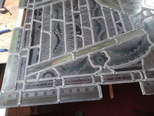 Linda Cameron has been making good progress repairing the four panels of the Forglen Hall window