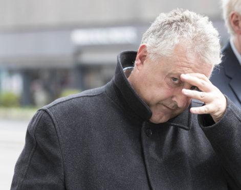 Frank James leaving court.