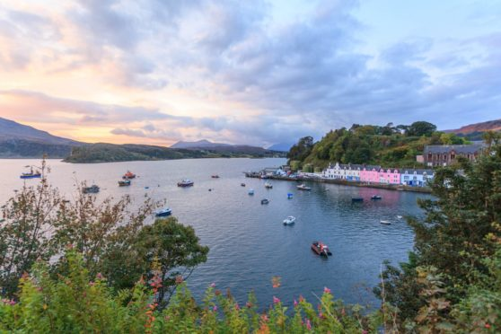 Overlooking the iconic houses and anchored boats in Portree harbour