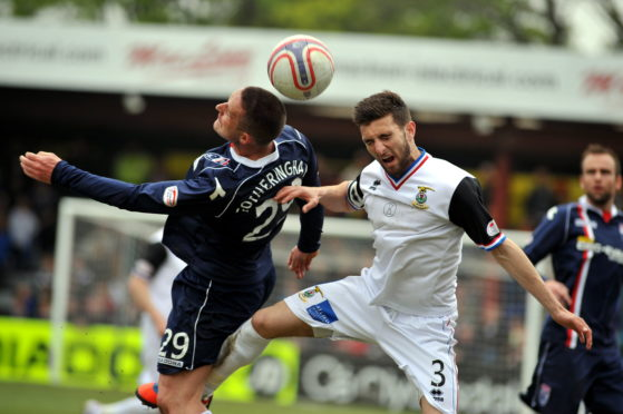 Ross County v Inverness Caledonian Thistle. Ross County's, Mark Fotheringham, left, and Caley Thistle's Graeme Shinnie, right. Picture by Gordon Lennox