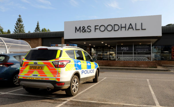 Police outside the M&S store in Oban.