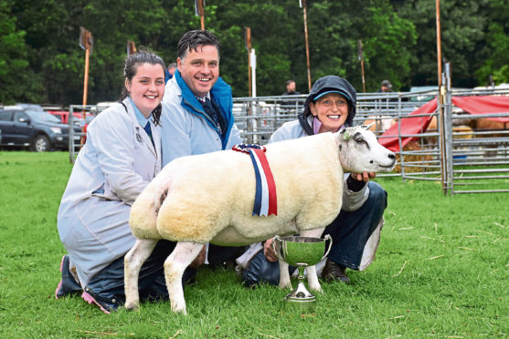 Graham and Fiona Burke, with daughter Rachel, at the 2019 Scottish National Beltex Show.