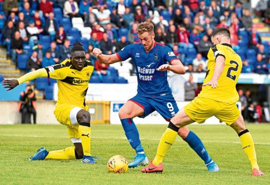 Inverness' Jordan White slips past Raith Rovers' Michael Miller and Fernandy Mendy