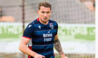 Callum Morris in action for Ross County.