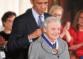 President Barack Obama (L) presents the Presidential Medal of Freedom to physicist Mildred Dresselhaus (R) during an East Room ceremony at the White House November 24, 2014
