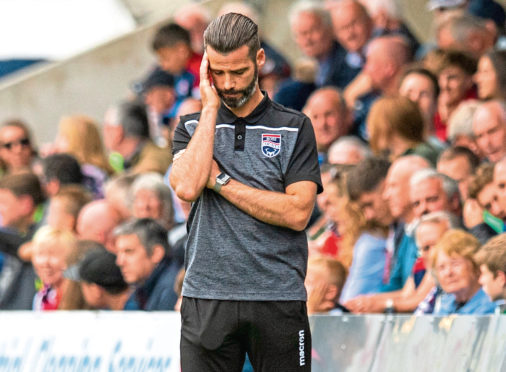 Ross County manager Stuart Kettlewell shows his frustration