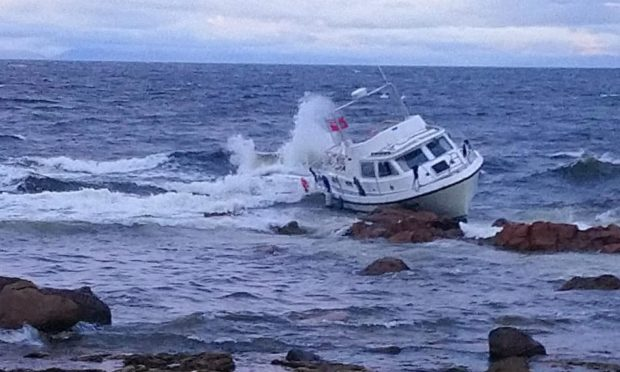 Coastguard rescue three 'extremely lucky' people after vessel runs aground | Press and Journal