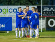 Cove Rangers players congratulate John Robertson after his late winner.