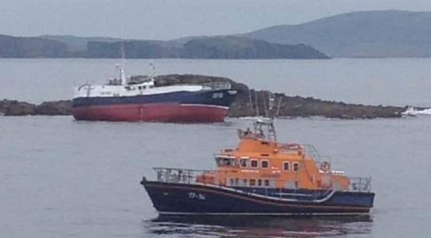 Fifteen crew members were dramatically rescued from the vessel after it ran aground in the Vee Skerries off Shetland, with Aith lifeboat standing by for large parts