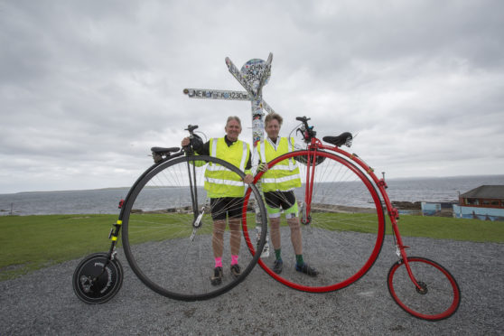 Neil Laughton (L) and David Fox-Pitt at John O'Groats after completing their marathon from Lands End, on Penny Farthing bicycles.