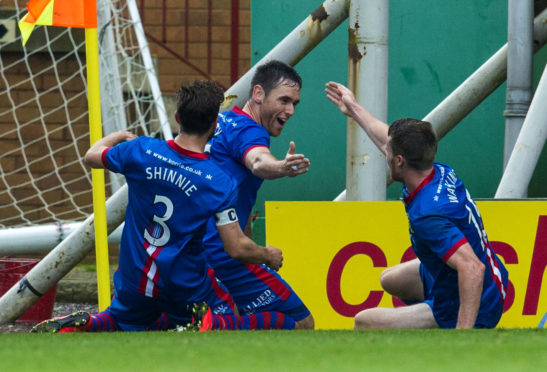ICT's Greg Tansey (centre) celebrates a goal against Motherwell in August 2014 with fellow team-mates Graeme Shinnie (left) and Marley Watkins.