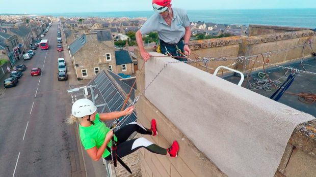 More than 70 people abseiled down the side of the Lossiemouth landmark.